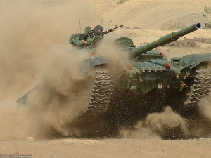 T-72B tank at high speed in the Indian desert.