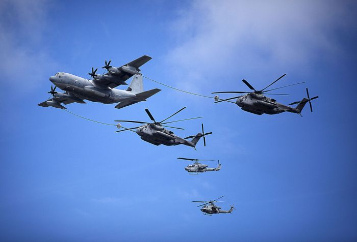 C-130 refuels two CH-53E Super Stallion helicopters