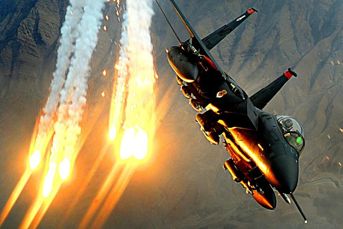 F-15 popping flares during a support operation